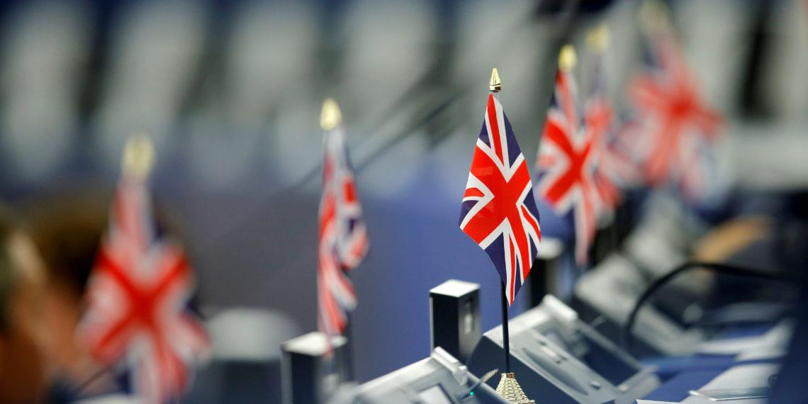 British Union Jack flags are seen on the desks of Members of the Brexit Party during a debate on the last European summit, at the European Parliament in Strasbourg