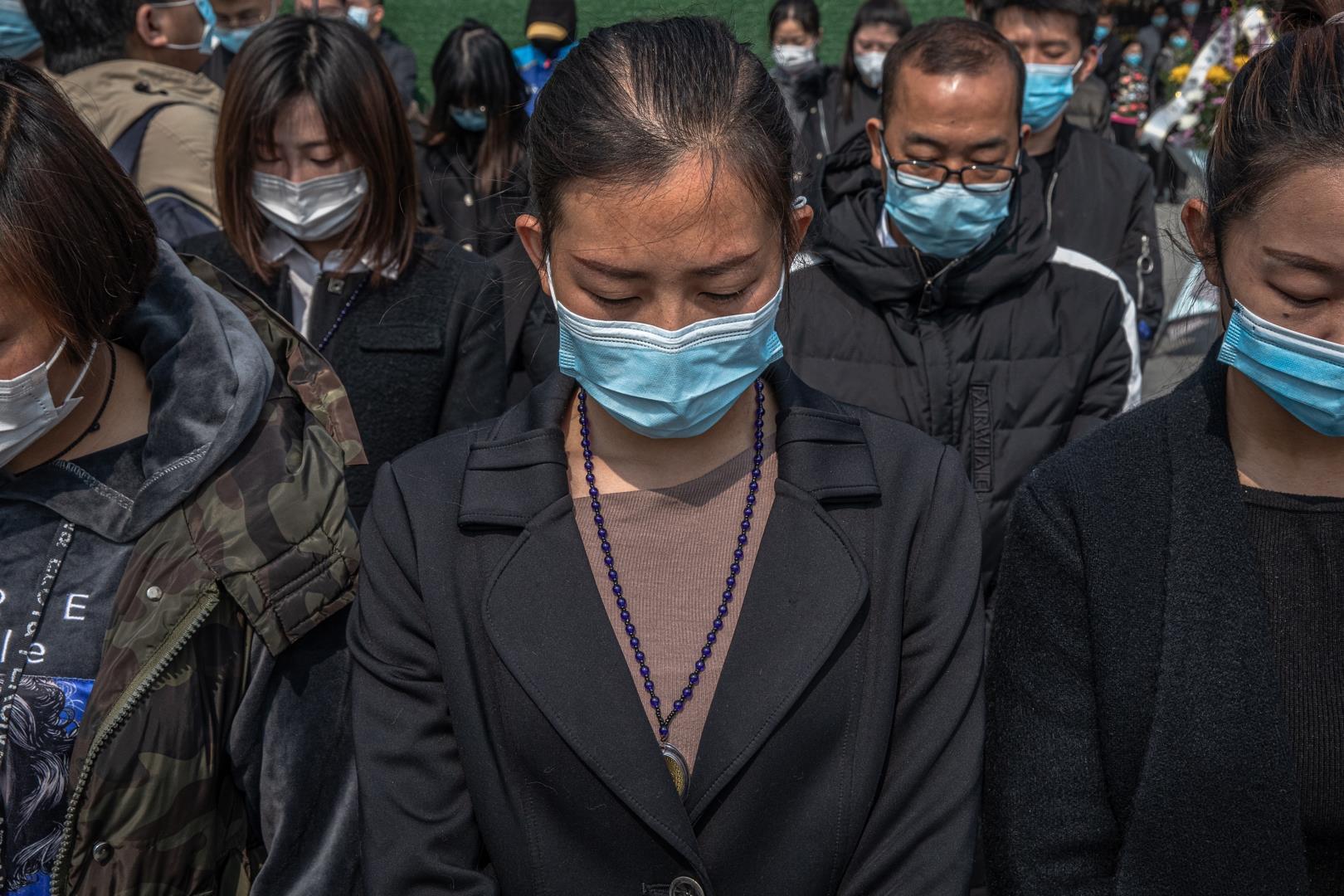 People observe three minutes of silence for victims of COVID-19, in China