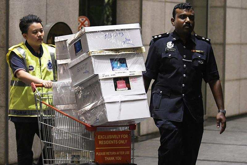 Authorities seize cash and luxury goods linked to former Prime Minister Najib Razak